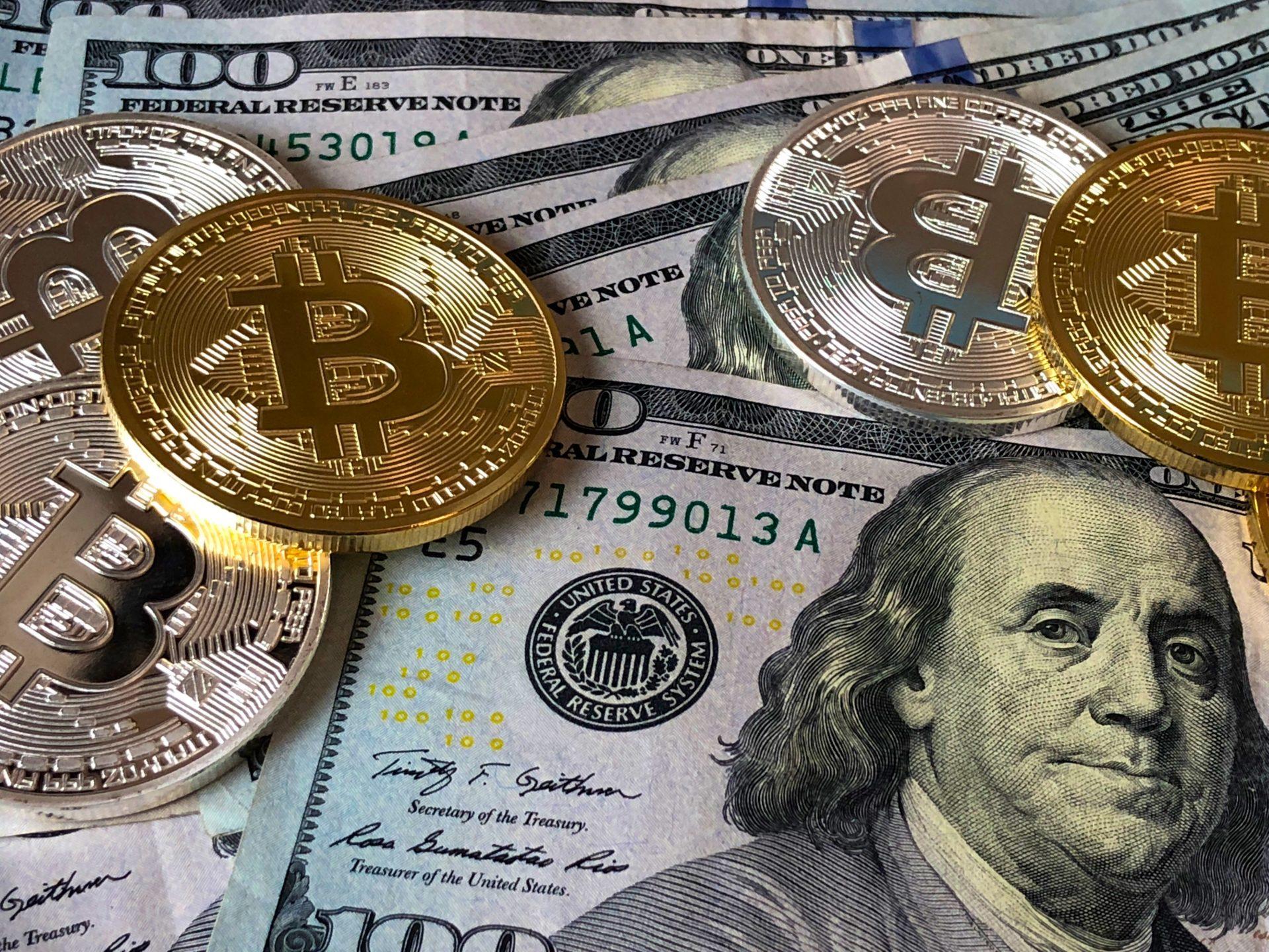 bitcoin coins dollar bills